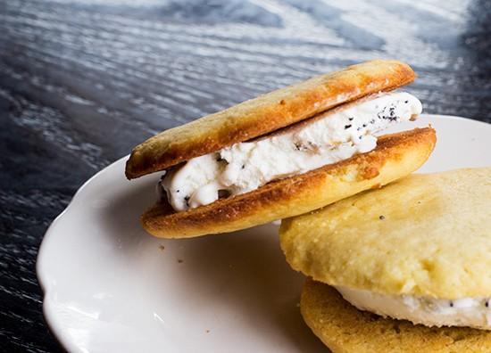 Vanilla wafer cookies with lemon-poppy-seed ice cream.