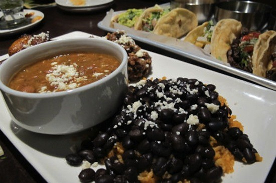 Charro beans and black beans with red chile rice at Vida Mexican Kitchen y Cantina. - REASE KIRCHNER