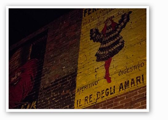 Art on the exposed brick. | Mabel Suen