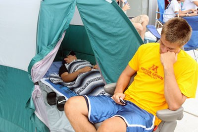 John Olson sleeps inside the tent, while Mark Mowery doses off. They arrived at 9 p.m. Wednesday.