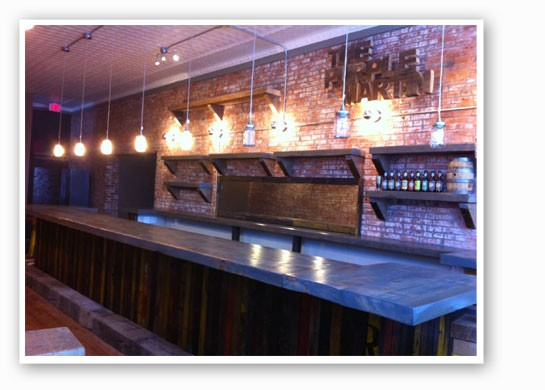 The reclaimed-wood bar inside the Purple Martin. | The Purple Martin