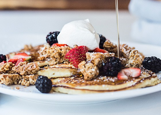 Granola pancakes with housemade granola, sweet cream, berries and maple syrup. | Jennifer Silverberg