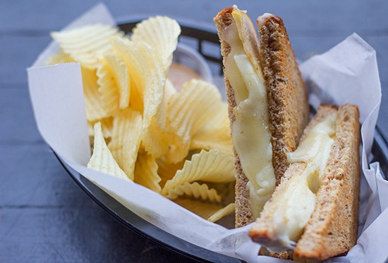 Hearty grilled cheese sandwich ($5), a melty blend of aged white cheddar, swiss and parmesan cheese with sliced apples.