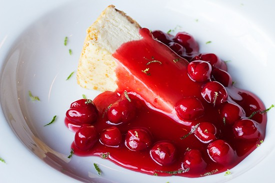 Cheesecake topped with bourbon cherry sauce and fresh lime zest.