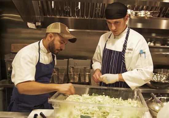 Executive chef Wilfrin Fernandez (left) instructs staff in the kitchen. - LIZ MILLER