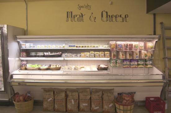 A huge selection of meat and cheeses reside next to the deli counter. - LIZ MILLER
