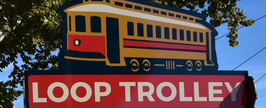 The trolley atop the sign has no passengers. That's a ballsy design choice. - DANIEL HILL