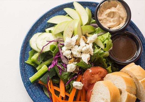 "The ""Division Street Salad"" with romaine, goat cheese, walnuts, apples, veggies and balsamic or tahini-maple dressing."