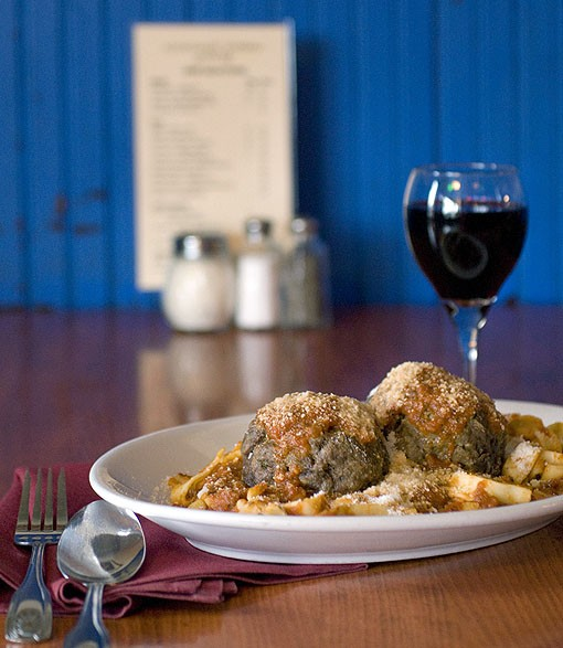 The pasta with these large house-made meatballs are served in the house marinara sauce. Here, served with a glass of Toscolo Chianti. See more photos from Anthonino's here. - PHOTO: JENNIFER SILVERBERG