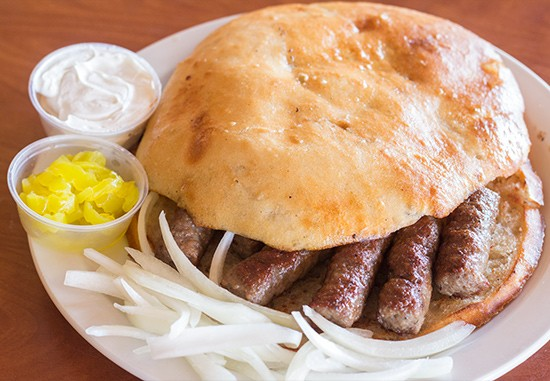 Cevapi, Bosnian flatbread with seasoned ground-beef sausages. | Photos by Mabel Suen