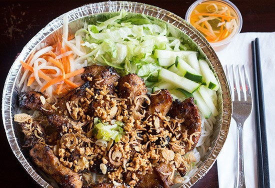 Grilled chicken with vermicelli noodles, shredded lettuce, cucumbers, pickled carrot and daikon, sauteed green onions, roasted peanuts, fried onions and housemade fish sauce.