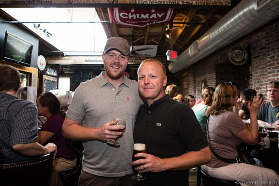 Cory King of Side Project Brewing (left) with International Tap House owner Brad Lobdell enjoying at beer at the Firkin Fest. - THEO WELLING