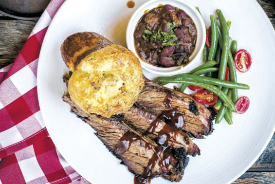 Brisket plate with a side of green bean and tomato salad and brisket chili. - JENNIFER SILVERBERG