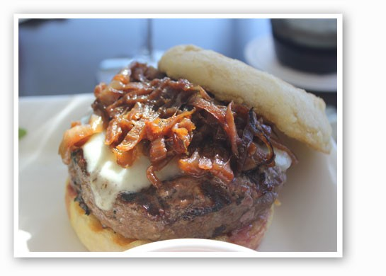 The Bixby's Midwest Chuck Burger on an English muffin with white chedder cheese, caramelized onions and smoked ketchup.   Nancy Stiles