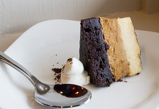 """The """"Espresso Amore"""" with layers of brownie, espresso mousse and Bailey's mousse, topped with cocoa powder and whipped cream."""