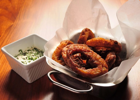 Buttermilk onion rings with buttermilk ranch and sweet hot barbecue sauce. | David Lancaster