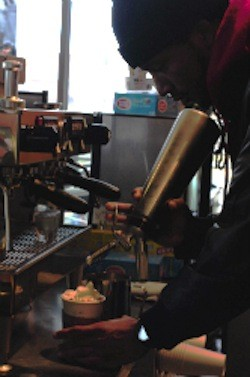 An employee puts the finishing touches on a hot chocolate at Chronicle Coffee. - CAILLIN MURRAY