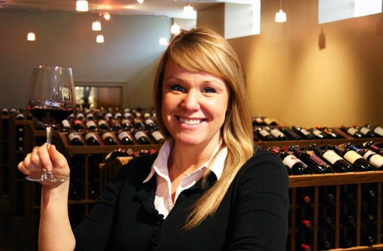 Renee Skubish of West End Wines demonstrates the best part of her job. - KATIE MOULTON