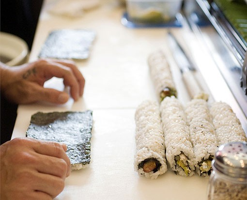Phan prepares sushi rolls. See more photos of Café Mochi on South Grand. - PHOTO: JENNIFER SILVERBERG