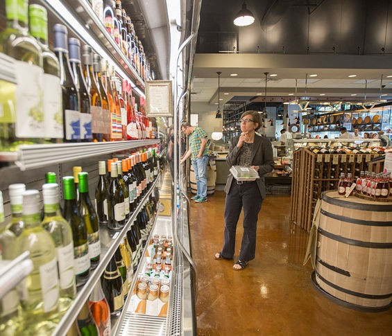 Wine in the beverage cooler at Central Table Food Hall. - JENNIFER SILVERBERG
