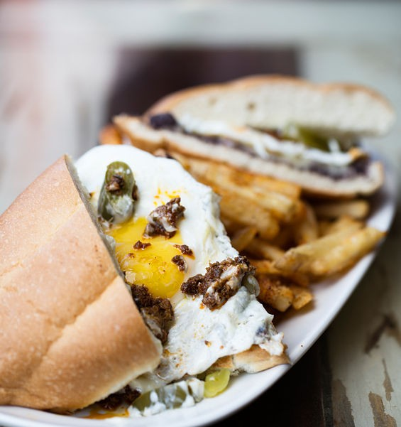 The Chorihuevo torta brings chorizo, fried egg, pickled jalapeno, smashed black beans, Chihuahua, garlic lime mayo. - JENNIFER SILVERBERG