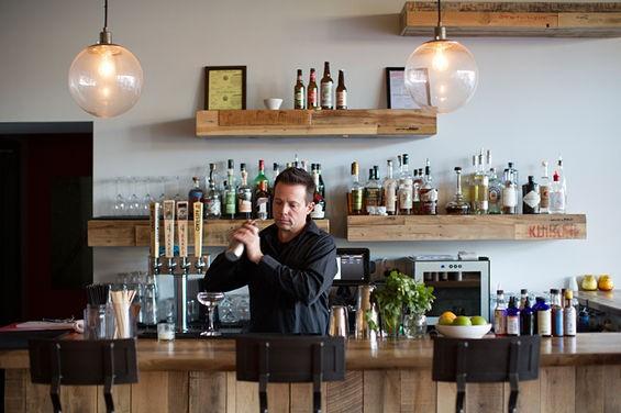 Bar manager Billy Holley crafts cocktails. - JENNIFER SILVERBERG