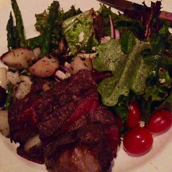 Steak salad with asparagus tips, roasted fingerling potatoes, mixed greens, roasted tomato vinaigrette, Gorgonzola cheese and red onion.| Nancy Stiles