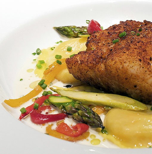 The chili-roasted Cod, one of the house specialties, is served with lobster ravioli, roasted peppers, grilled asparagus and Champagne sauce. See more photos from inside Hanley's in this slideshow. - PHOTO: JENNIFER SILVERBERG