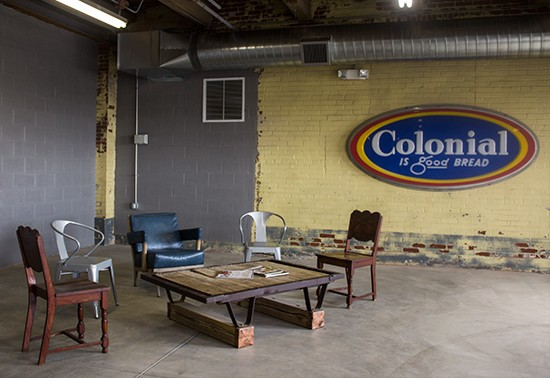 A waiting area outside the restaurant exemplifies the brewery's vintage aesthetic.