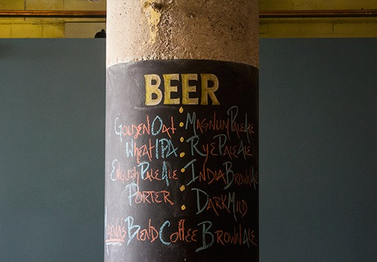 Chalk menus painted on pillars reveal the brewery's latest offerings.