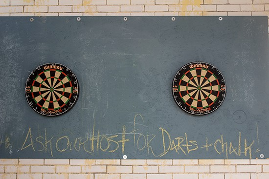 Look for dart boards in the corner of the spacious room.