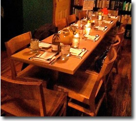 The Mud House offers family-style seating at tables that used to be bowling-lane surfaces. - HOLLY FANN