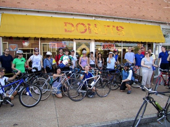 Tour D'Onut bikers line up in front of John Donut before moseying to the second shop. - AMANDA WOYTUS