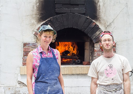 Red Fox Baking's Jenny Wilson and Jake Marks by their wood-fired brick oven.