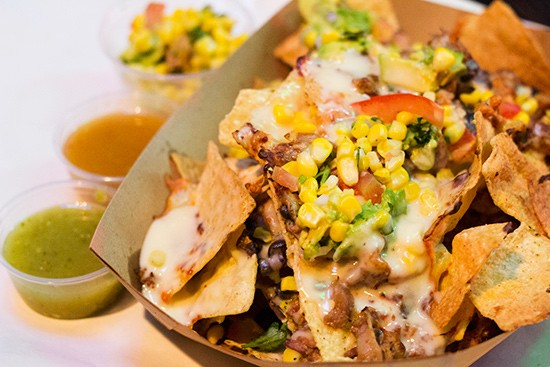 """Mokoso"" nachos with corn, pineapple, bacon, jalapeno and a five-cheese blend."