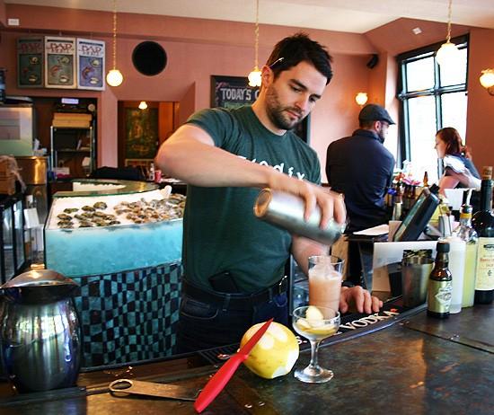 TJ Vytlacil pours an award-winning Love Burns cocktail at DeMun Oyster Bar. - KATIE MOULTON