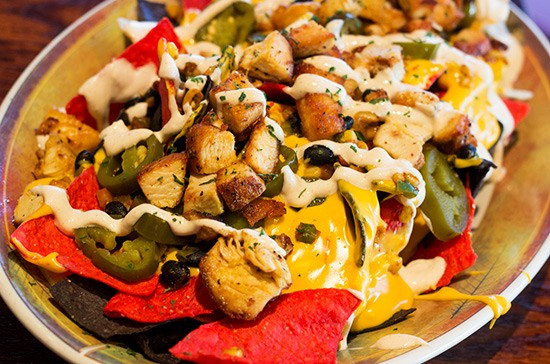"""All Aboard Nachos"" with grilled chicken."