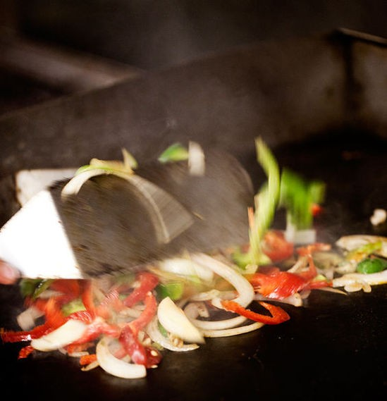 Grilling vegetables and meat for fajitas at Fiesta! Modern Mexican Cuisine - JENNIFER SILVERBERG