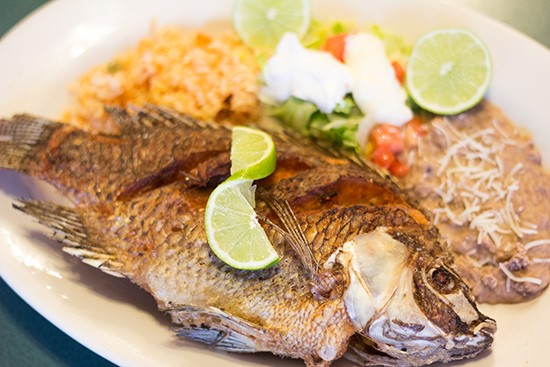Mojarras: whole tilapia marinated, then fried.
