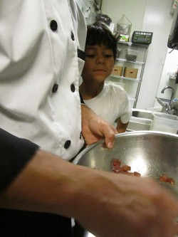 Jason works on the ceviche while Julian watches. - STACY ANDERSON