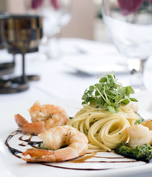 Our plated third course, shrimp scampi. The Shrimp Scampi is a combination of Seasons' house-made linguine, chiffonade of fresh basil, toasted pine nuts, grated parmesan, white wine garlic sauce, house-made pesto and balsamic gastrique. See more photos from Seasons St. Louis here. - PHOTO: JENNIFER SILVERBERG