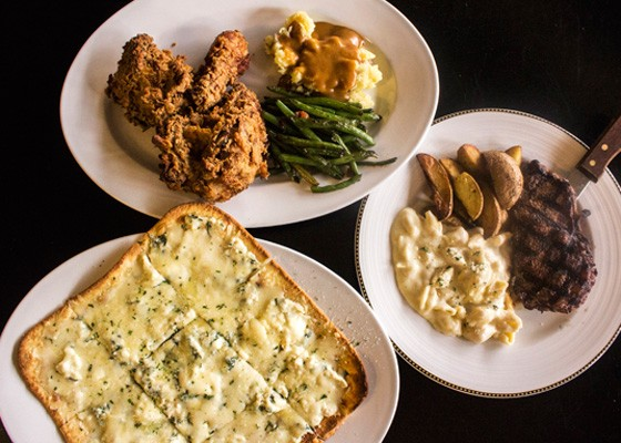 The flatbread (roasted chicken spinach dip spread on stone-baked naan and smothered in provel and mozzarella cheese), fried chicken and ribeye at Cooper's. | Mabel Suen