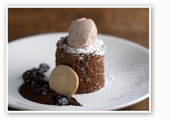 Chocolate souffle cake with sun-dried-cherry ice cream at the Restaurant. | Jennifer        Silverberg