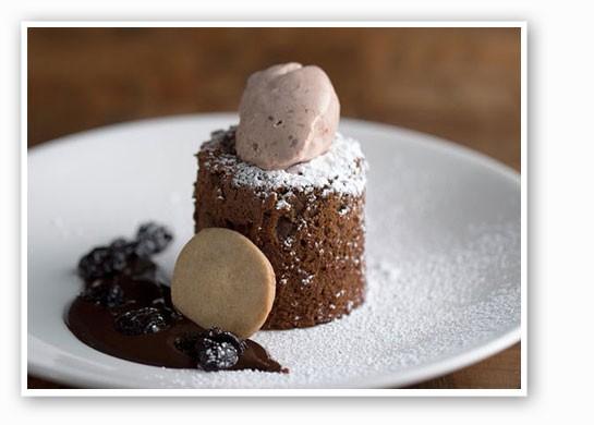 Chocolate souffle cake with sun-dried-cherry ice cream at the Restaurant. | Jennifer Silverberg
