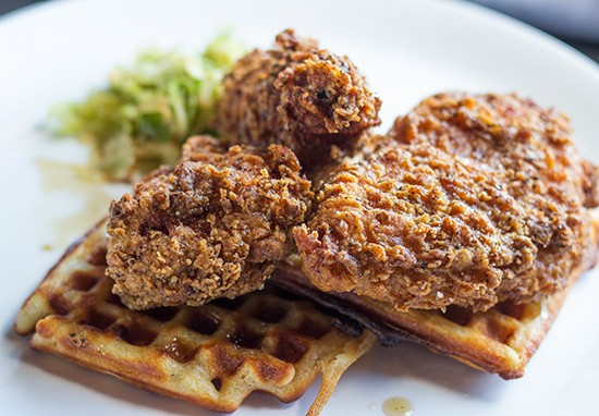 Duck fried chicken with waffles, Brussels sprouts slaw and bacon syrup.
