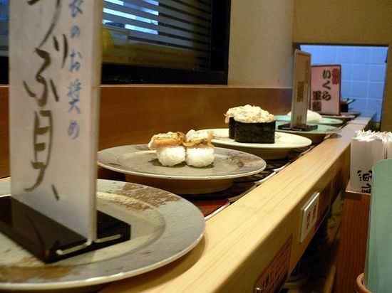 A conveyor-belt sushi restaurant in Japan - IMAGE VIA