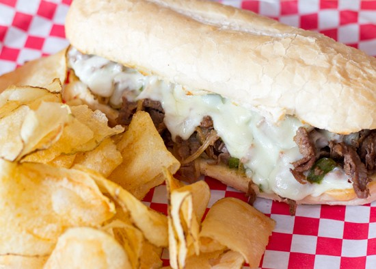 A Philly cheesesteak with housemade chips.