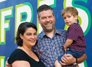 David Warner and Kristine Cortese, owners of City Feed and Supply, with their son. - IMAGE SOURCE