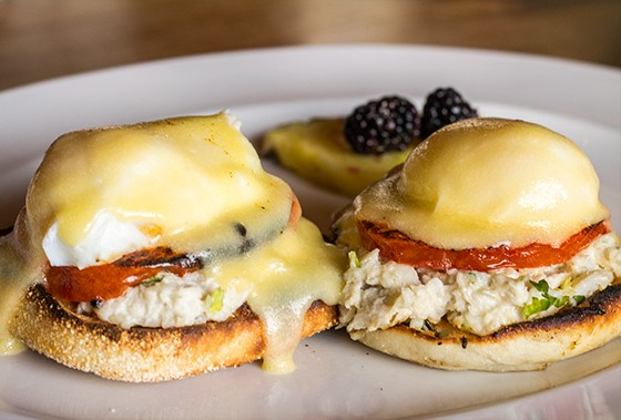 """Benedict"" with crab, poached eggs, charred tomato, English muffin and bernaise."