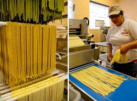 An employee runs a test batch of pasta through a cutter. - MABEL SUEN